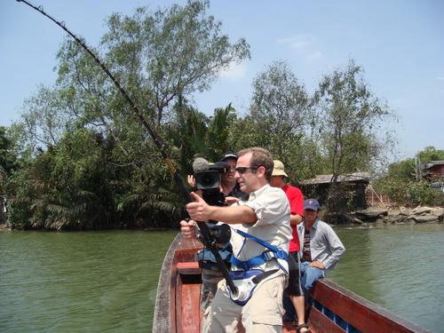 Robson Green filming extreme fishing Thailand playing a freshwater stingray